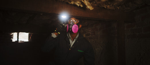 Technician in crawl space